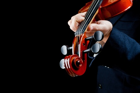 particularly of the hands of the violinist, playing the notes