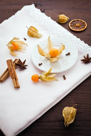 cape gooseberry: physalis,anice,cinnamon,cloves and orange over napkin