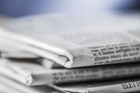 newspaper reading: newspaper,document for information