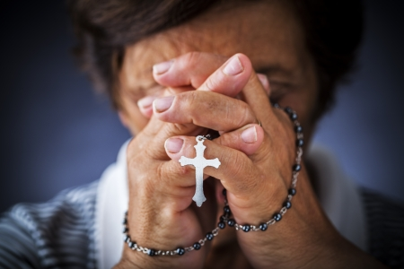 religion ritual: Praying with a rosary