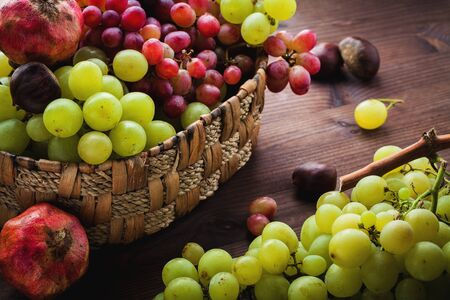 Wicker basket with autumn fruits  photo