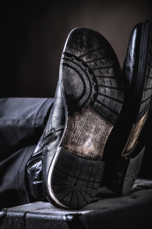 valise: leather boots on valise