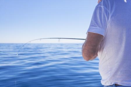 ocean fishing: fisherman in boat