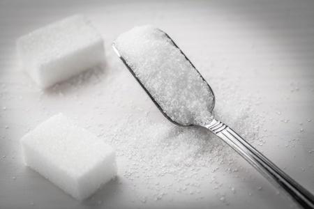 granulated: sugar and spoon