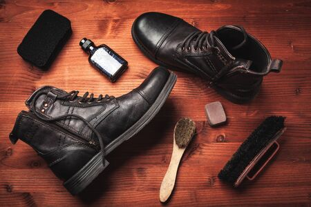 clean vintage boots with wax, sponges and brushes