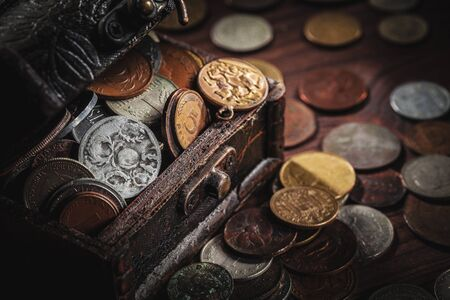neologism: old coins in chest