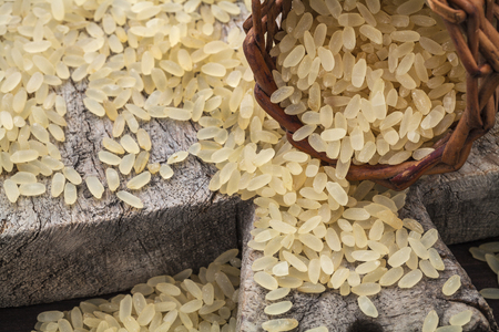 protein crops: brown rice on cutting board