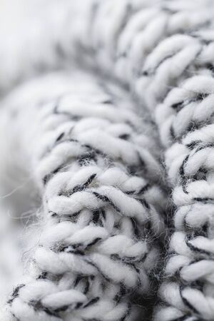 Wool fabrics for the cold winter. Hat and sweater. macro
