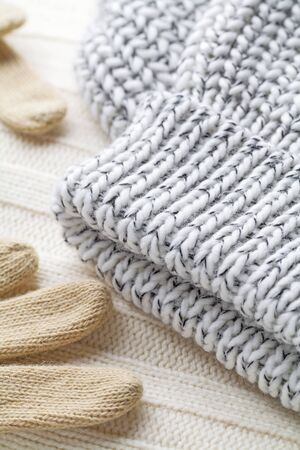 Wool fabrics for the cold winter. Hat, gloves and sweater.