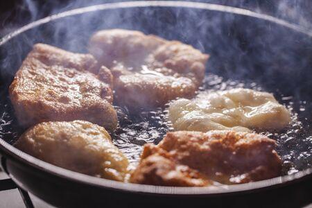 fritters fry on frying pan Standard-Bild