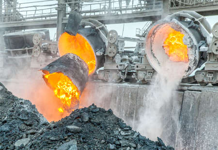 steel mill: Hot steel pouring in steel plant Stock Photo