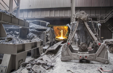 sweltering: Hot steel pouring in steel plant Editorial
