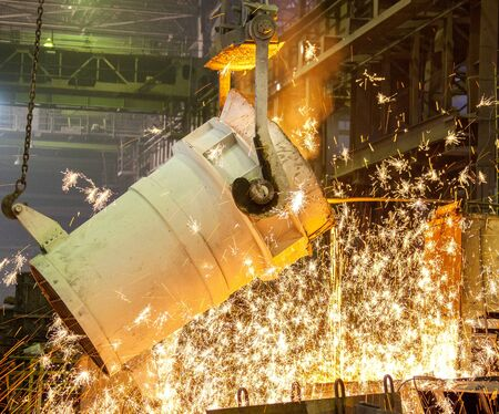 steel plant: Hot steel pouring in steel plant Stock Photo
