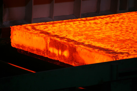red hot iron: hot steel slab heated in the furnace Stock Photo