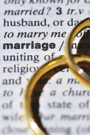 english dictionary: Two wedding rings next to the word marriage, on a english dictionary
