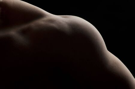 trapezius: Detail of part of a male torso, featuring trapezius, deltoid and triceps muscles Stock Photo