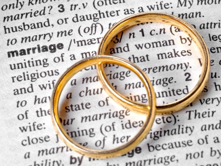 commitment: Two wedding rings next to the word  Stock Photo