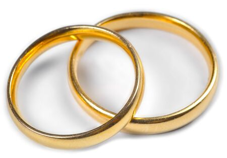 vow: Two wedding rings on a white background.