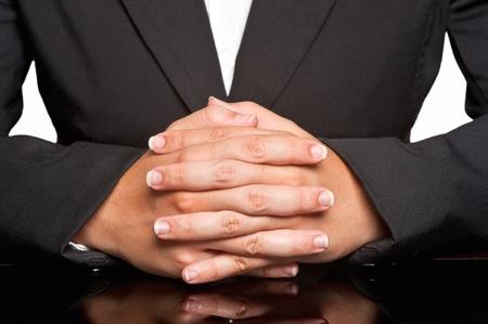 entrevista: Mujer de negocios esperando con los dedos cruzados Foto de archivo
