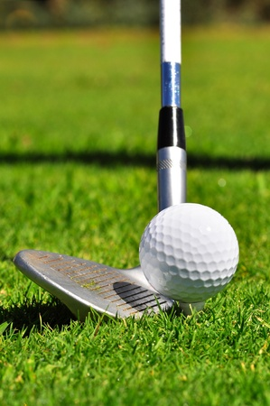 target practice: Golf ball and driver, ready to strike, on a real golf course. Stock Photo