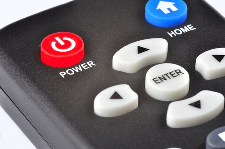 sports programme: A remote control. Focus is on the power button.