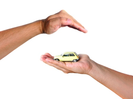 Two hands facing each other, protect a yellow car Stock Photo - 10621907