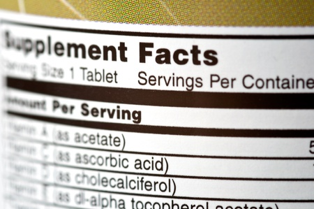 supplements: Closeup of a bottle of vitamins