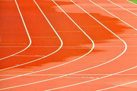 Details of a wet athletics running track photo