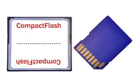 A Compact Flash and a SD Card side by side, isolated in white photo