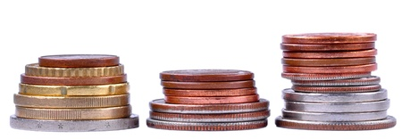 Three piles of coins next to each other Stock Photo - 10661691