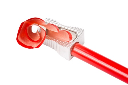 secretarial: A red sharp pencil being sharpened by a pencil sharpener