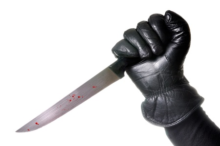 Hand holding bloody knife with glow around the hand and forearm. White background, isolated. Stock Photo - 10811360