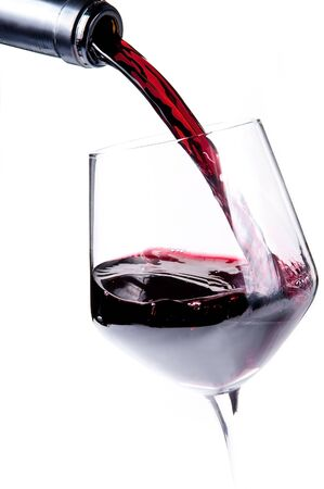 inebriated: Bottle pouring red wine into a wine glass Stock Photo