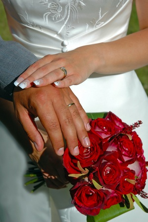 Wedding bouquet and rings of a newlywed couple Stock Photo - 11480695