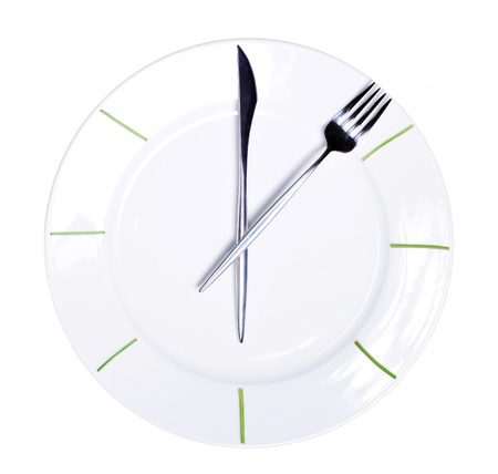Clock made of knife and fork, isolated on white background