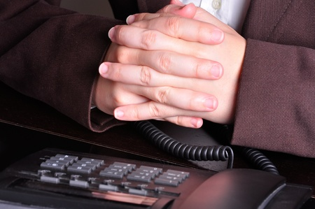 Businessperson with hands crossed waiting for the phone to ring Stock Photo - 13139124