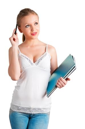 teenager thinking: Joven mujer llevando cuadernos en sus brazos Foto de archivo
