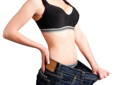 Woman seeing results from her diet photo