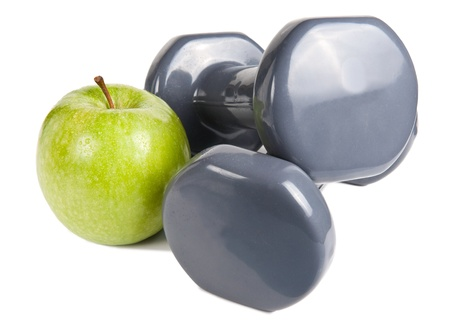 Apple and a pair of dumbbells. Exercise and healthy diet concept. photo