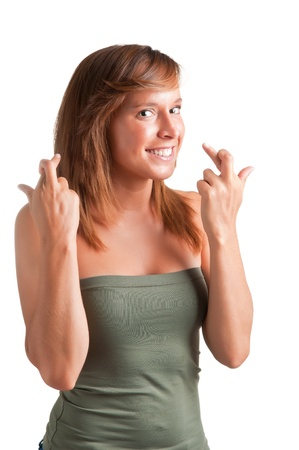 Happy young woman crossing her fingers to wish something Stock Photo - 14343373