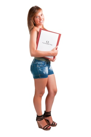 Young woman with a notepad and a curriculum vitae in her arms Stock Photo - 14343361