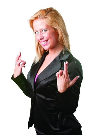 Businesswoman crossing her fingers isolated in a white background Stock Photo - 14506793