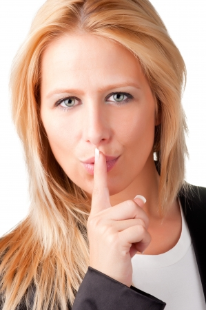 sense of security: Business woman with her finger over her mouth, isolated in a white background Stock Photo