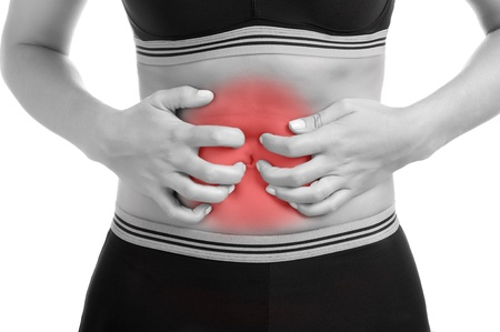 Woman suffering from stomach pain. Black and White with a red spot around the painful area