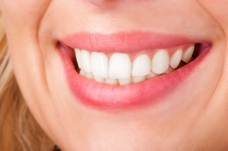 teeths: Smiling womans mouth with great white teeths