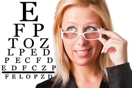 Worried bussinesswoman with glasses looking at an eyechart, isolated in a white background photo