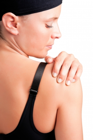 Young woman with pain in her shoulder photo