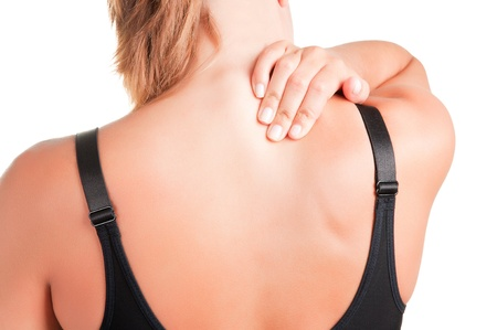 Young woman with pain in the back of her neck photo