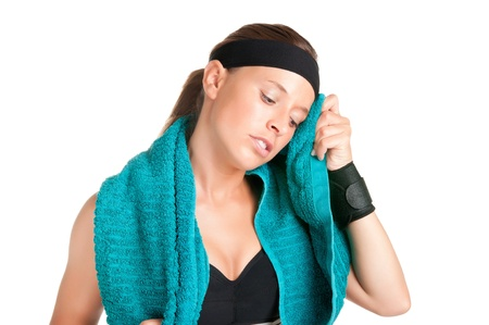 Woman resting and cleaning up her face after a fitness workout photo