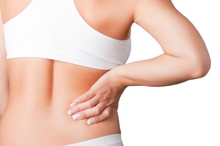 soreness: Young woman with pain in her lower back